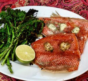 salmon dotted with pats of butter